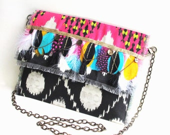 Boho pocket with black and pink feathers, pompons, medals