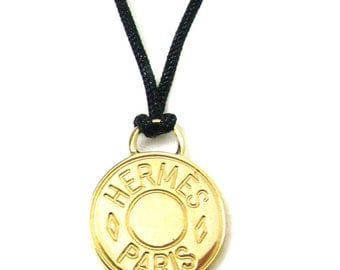 HERMES, superb highlight of saddle gold metal pendant