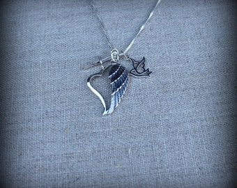 Angel wing necklace. Angel wing, cross and dove necklace
