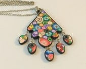 Long millefiori necklace, polymer clay colorful necklace, colorful clay necklace, handmade necklace, artisan jewelry design in polymer clay.