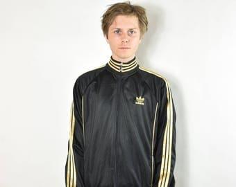 120c651bd72 adidas jasje zwart goud