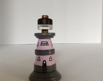 Lighthouse  from clay pots//repurposed art//lighthouse from recycled items//lighthouse