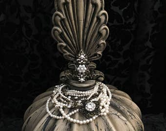 This is a beautiful decorative bottle with pearls.