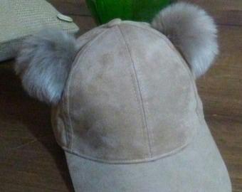 light brown baseball hat with pompoms