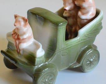 Pigs in an early model car, ceramic Edwardian fairing, c. 1904
