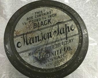 vintage small tin manson tape