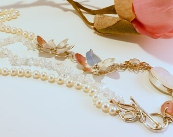 necklace of silver with precious stones and pearls