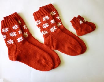 Family socks. Three pairs of socks. For dad, mom and baby. Knitted socks. Woolen warm socks.