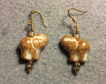 Beige and cream Czech glass elephant earrings adorned with beige Czech glass beads.