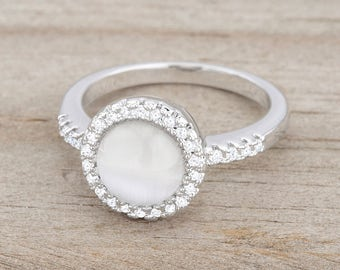 Cat's Eye Ring | White | Small, delicate stones accent a round, solitary white cat's eye stone in this femininely classic ring