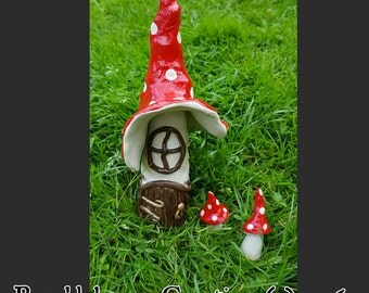 Toadstool Cottage and matching toadstools.
