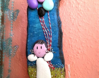 Girl with balloons picture of sea and rocks, wood art, art with stones instante