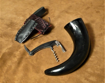 Drinking horn, all black, with corkscrew accessory and belt holster