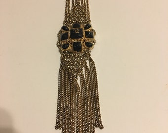 Long gold Costume necklace with black and gold Chanel coat button