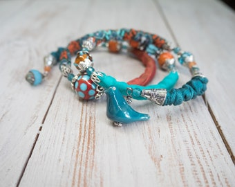 Three-pass bracelet, ceramic, raku beads, bird patterned fabric, bangles, Orange, turquoise, spring, gift for her