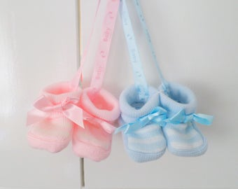 Baby booties hanging pram charm with satin ribbon blue or pink