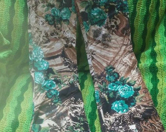 Preloved funky printed bootleg under hip fit .excellent condition .size 5.buddhas ,tigers ,teal flowers.free shipping