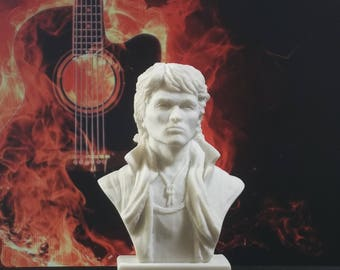 Soviet Russian rock singer Viktor Tsoy bust. Symbol of Russian rock. Made of marble chips. For rock fans. USSR legacy.