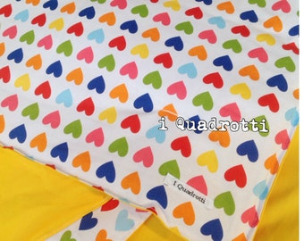 Quilt with colored hearts