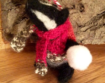 Badger needle felted Christmas tree decoration. Mr Badger comes in a knitted vest and scarf with his own snowball