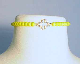Yellow beaded choker with crystal clover charm