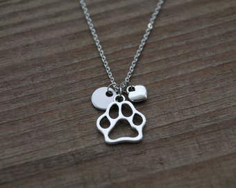 Paw print necklace.