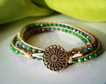 Chayana ~ A blue/green colored wrap bracelet with copper button clasp