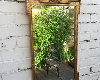 Beautiful gold ornate mirror with fantastic detail around the frame.