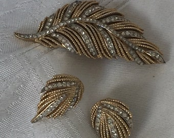 Vintage Crown Trifari gold tone and rhinestone leaf brooch and earrings