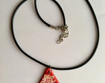 Handmade red triangle necklace with pattern detail