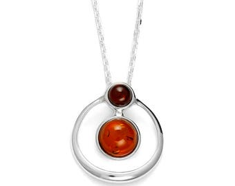 Necklace in bicolor amber mounted on rhodium silver.