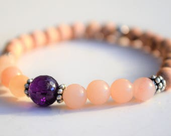 Rose pink aventurine with rosewood and sterling silver beads and faceted amethyst feature bead