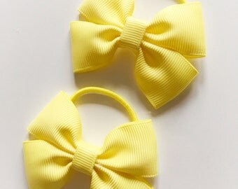 Pair of yellow bobbles - pigtail bobbles, hair bows, hair elastics