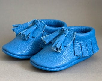 Blue moccasins with tassels