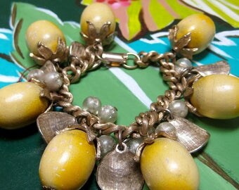 Yellow wood beads 1950s charm bracelet