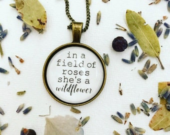 In A Field of Roses She's a Wildflower Necklace