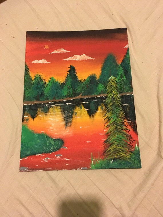 Orange landscape painting on 12 by 16 inch flat canvas