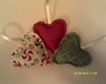 SALE Xmas Baubles.3 xmas fabric padded hearts with hangers.Take pot luck for 3 pounds a pack of 3.