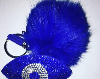 Pompom. Pom pom. Evil eye pompom.  Evil eye pom pom.  Evil eye.  Handbag accessory.  Real fur pompom.  Real fur pom pom.  Evil eye keychain.