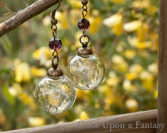 Flight of dandelion earrings pearls mauve