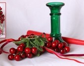 Vintage Cranberry Christmas Candle Table Decoration. Green Glass Candlestick with cranberry decoration and ribbons.