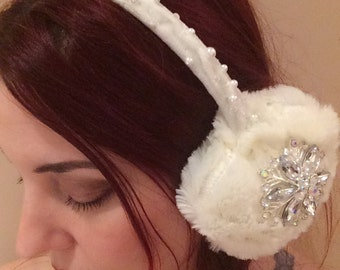 White beaded earmuffs adorned with crystal jewels