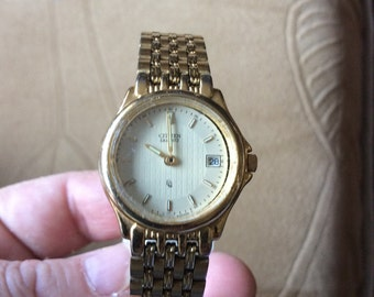 Gold tone vintage citizens watch