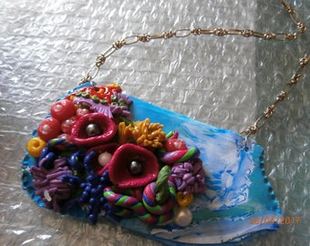 A remote island in the Pacific. Polymer clay necklace. Colors of the sea