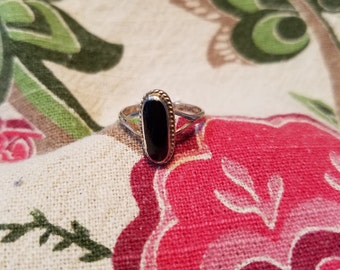 Sweet and dainty black onyx ring , set in sterling silver. Size 5