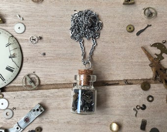 Necklace with glass bottle filled with watch movement parts - nickelfree - steampunk jewelry - made by: Handmade by Charlie