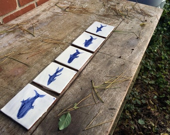 Set of five handmade ceramic fish tiles