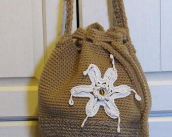 Tan crochet shoulder bag, yarn and jute