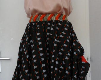 Wax, strip with sliding tie skirt on the sides