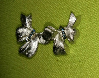 Vintage Trifari silver tone bow clip earrings with blue faux stones